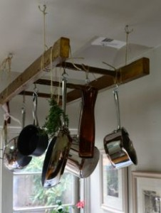Try using a ladder for hanging pots and pans