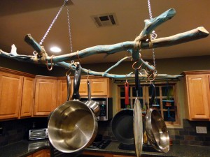 Look outside your home for a great rack to hang your pots and pans on.
